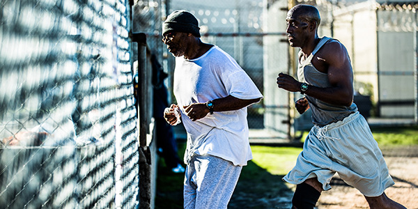 Two men exercising in a prison