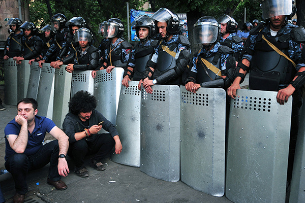 A line of police holding shields