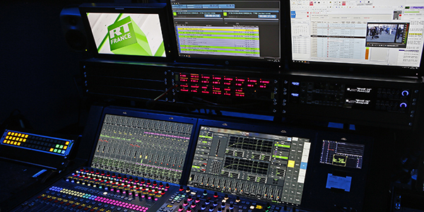 An audio/video production mixing console and monitors