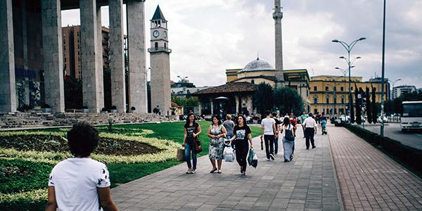 People walking on a sidewalk