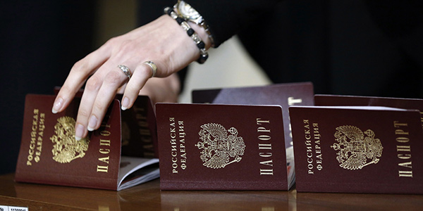 A woman's hand touching a passport